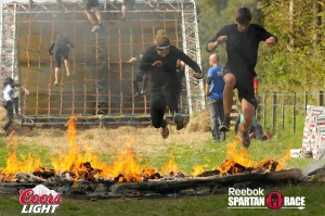 Jumping over the fire at the Spartan race